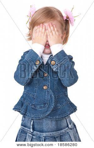 girl hide face under hands. play hide-and-seek