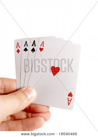 Four aces in the hand isolated on white
