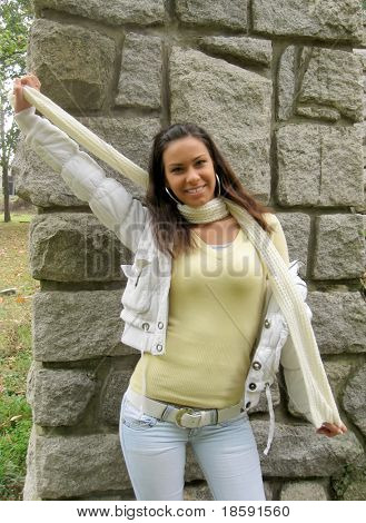 Young girl with shawl along the stone wall