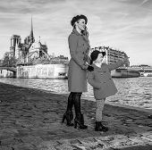 Mother And Daughter Travellers In Paris Pointing At Something poster