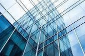 stock photo of symmetrical  - transparent glass wall of office building - JPG