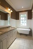 pic of wainscoting  - bathroom in affluent home with clawfoot tub - JPG