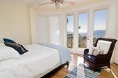pic of opulence  - hotel or residential bedroom with gorgeous view of the ocean - JPG