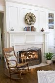 stock photo of cozy hearth  - cozy fireplace and rocking chair - JPG