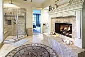stock photo of opulence  - opulent bathroom with fireplace - JPG