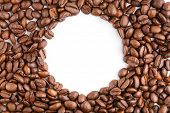 Roasted Coffee Beans Isolated In White Background. Roasted Coffee Beans Background Close Up. Coffee poster