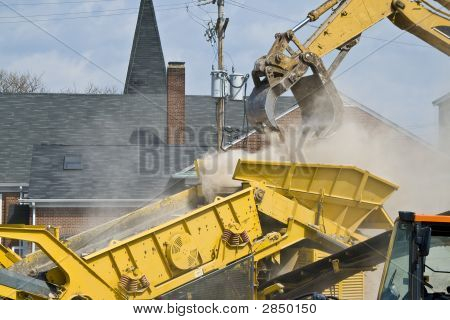 Construction Site With Rubble Being Put Into A Dump Truck 3