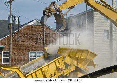 Construction Site With Rubble Being Put Into A Dump Truck 2