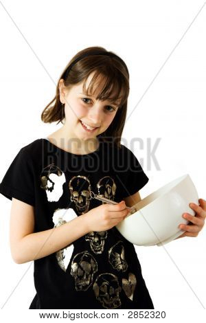 Young Girl Mixing A Cake 1