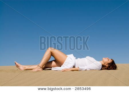 Woman Lying In The Sand