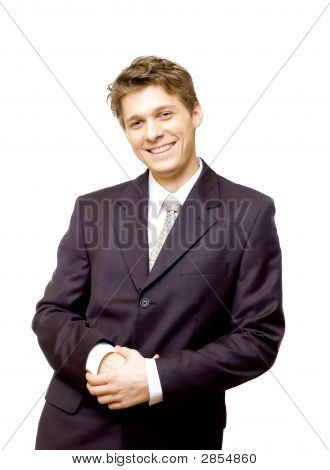 Young Happy Businessman Leaning Against