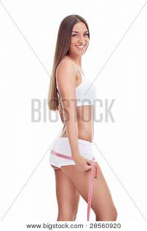 Beautiful happy woman with perfect body measuring buttocks with measurement tape,  isolated on white