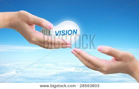 sending vision light bulb on women hand