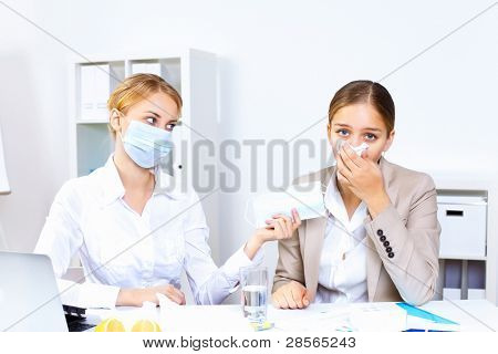 Young woman feeling unwell and sick in office