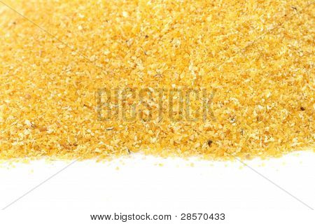 Yellow cornflour scattered