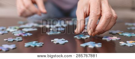 poster of Alzheimers Disease, Dementia, Memory Loss And Mental Health Concept. Hands Of Old Woman With Jigsaw