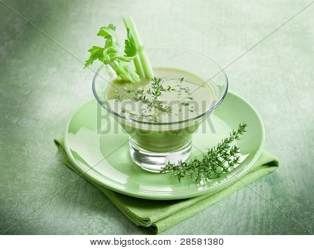 Celery cream soup with thymus on glass