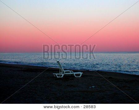 Deserted Chair On Beach