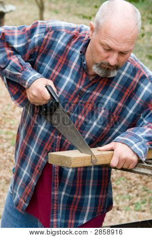 Man Cutting Board With Hand Saw