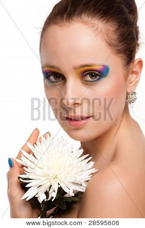 Beautiful Young Woman With A Flower.
