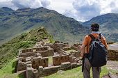 Tourist Exploring The Inca Trails Leading To The Ruins Of Pisac, Sacred Valley, Major Travel Destina poster
