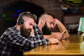 Hipster Bearded Man Spend Leisure At Bar Counter. Order Drinks At Bar Counter. Men With Headphones A poster