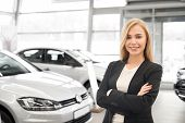 Beautiful, Charming Blonde Working In Car Dealership As Manager. Professional Female Dealer Looking  poster