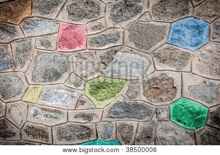 Grey Stone Wall With Bright Colored Blocks.