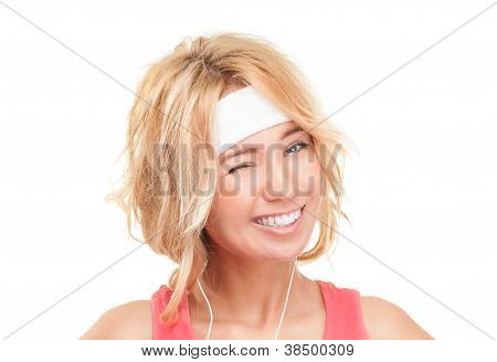 Young Sporty Woman Winking On White Background.