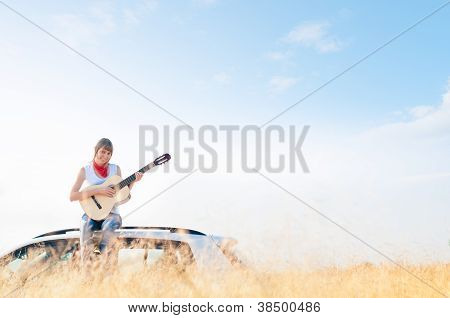 Young Free Musician Woman Outdoor On Blue Sky.
