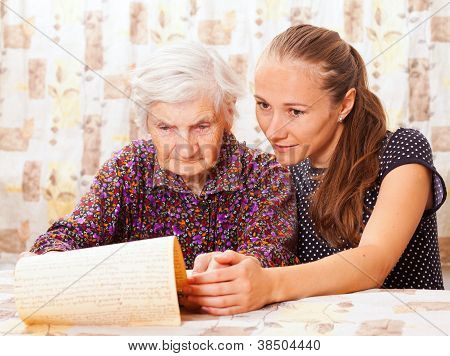 Young Doctor Holds The Old  Woman's Hand