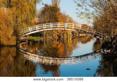 White Bridge Reflected In The Water Surface