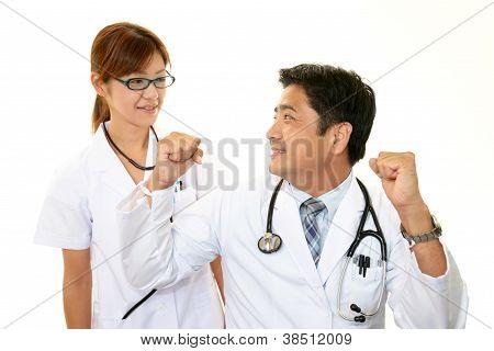 Smiling asian medical doctor
