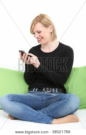 Happy Woman Texting On Her Mobile