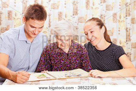 Elderly Woman With The Two Young Smileing Grandchild