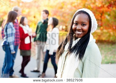 Young Woman Smiling With Friends In The Background