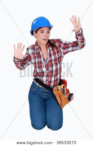 Tradeswoman stuck behind an invisible wall