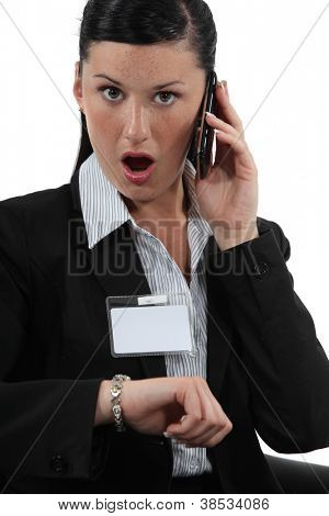 Shocked businesswoman talking on her cellphone