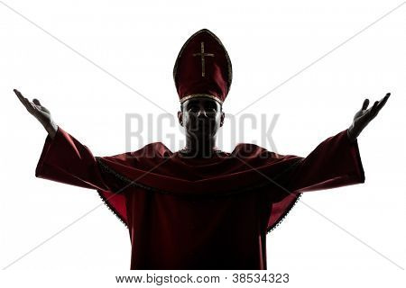 one man cardinal bishop silhouette saluting blessing in studio isolated on white background