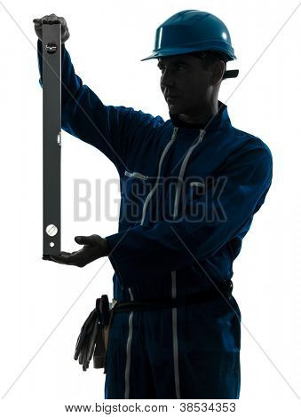 one caucasian man construction worker holding level silhouette in studio on white background