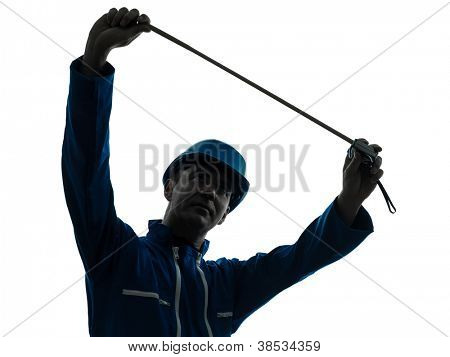 one caucasian man construction worker Tape Measure silhouette in studio on white background