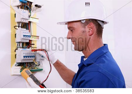 electrician measuring voltage