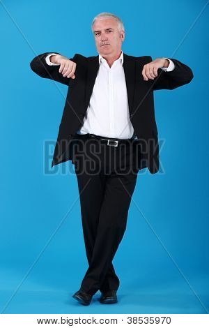 Grey-haired businessman lifting arms