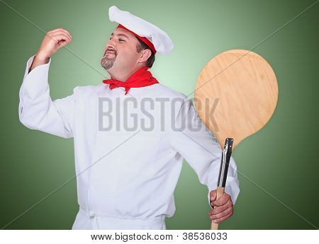 Portrait of a pizza maker