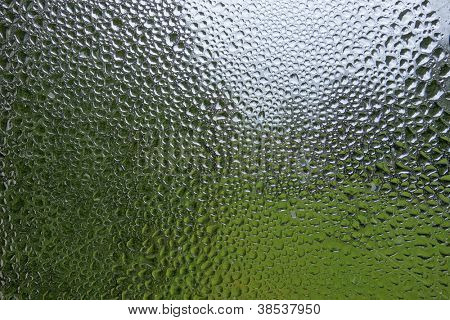 Water condensation and rain drops pattern on a window.