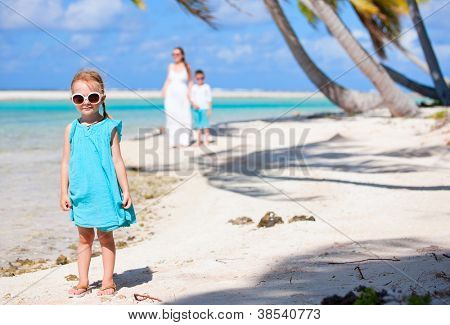 Little girl on a beach at tropical island
