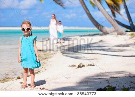 Little girl on a beach at tropical island