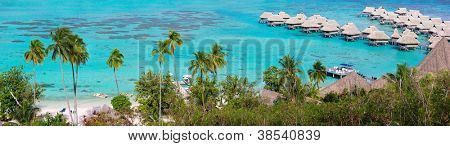 Panorama of a beautiful coast and over water bungalows at Moorea island