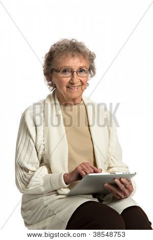 80 Year Old Elderly Senior Texting on Tablet Computer Isolated on White Background