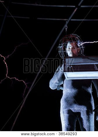 NEW YORK - OCT 6: Endurance artist David Blaine is struck by a spark of electric current from a Tesla coil during the live streaming event called 'Electrified' in New York on October 6, 2012.